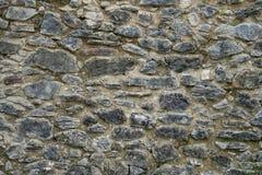 Alte beige und graue Wand mit Steinmaurerarbeit mit Sprüngen, backgrou Stockfotos