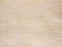 Alte beige Wand, helle Beschaffenheit, Hintergrund für Design Lizenzfreies Stockbild