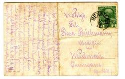 Alte benutzte Postkarte Stockfoto