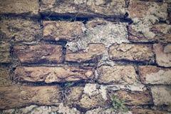 Alte Beschaffenheit einer alten Backsteinmauer im Retrostil Stockfotos