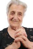 Alte betende Frau Stockbild