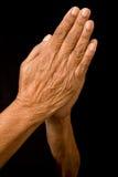 Alte betende Hände Stockfotos