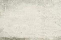 Alte Betonmauer der Beschaffenheit mit Überresten des Gipses Stockfotografie