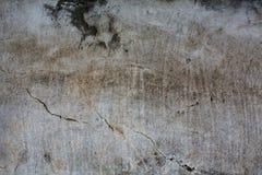 Alte Betonmauer mit gebrochener Beschaffenheit Stockfotografie