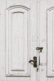 Alte beunruhigte weiße Türen Lizenzfreies Stockfoto