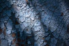 Alte blaue Farbe der Beschaffenheit und des Hintergrundes in den Sprüngen Lizenzfreie Stockfotos