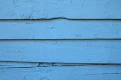 Alte blaue gemalte hölzerne Wand Stockbild