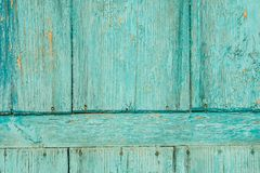 Alte blaue Holztür mit alten rostigen Nägeln und Schale malen Hintergrund Stockfotografie