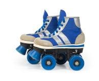 Alte blaue Rollerblades Lizenzfreies Stockfoto