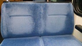 Alte blaue Sitze Stockfotos