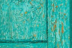 Alte blaue Tür mit Schalenfarben-Hintergrundmakro Stockfotografie