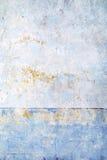 Alte blaue Wand mit verkratzter Farbe Stockfoto
