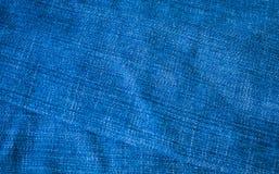 Alte Blue Jeans-Beschaffenheit für Hintergrund Lizenzfreie Stockfotos