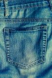 Alte Blue Jeans mit Tasche mit Nähten Stockfotografie