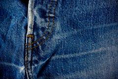 Alte Blue Jeans säumen Detailstoff des Denims für Muster und klassischen Hintergrundabschluß oben Lizenzfreies Stockbild