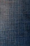 Alte Blue Jeans während einer sehr langen Zeit Stockfoto