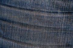 Alte Blue Jeans während einer sehr langen Zeit Lizenzfreies Stockbild