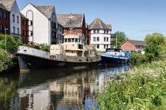 Alte Boote entlang dem Exeter-Kanal Stockbilder
