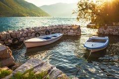 Alte Boote im Sonnenunterganglicht Lizenzfreies Stockfoto