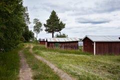 Alte Bootshäuser in Schweden Stockfotos