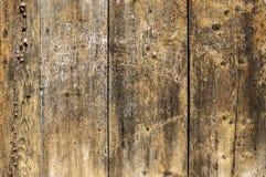 Alte braune hölzerne Wand mit Kratzern Stockfotografie