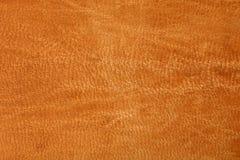 Alte braune orange lederne Hintergrundbeschaffenheit Stockfotos