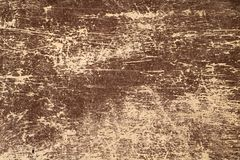 Alte braune Schale und verkratzte gealterte Farbe auf verwitterter hölzerner Boa Lizenzfreies Stockfoto