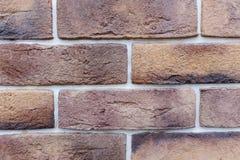 Alte braune Ziegelstein-Wand-Musterbacksteinmauerbeschaffenheit oder Backsteinmauerhintergrundlicht für Innen- oder Außenbackstei Stockfotos