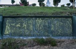 Alte buddhistische Malerei geschnitzt auf dem Brett lizenzfreies stockbild