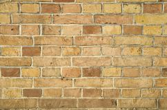 Alte bunte Backsteinmauernahaufnahme Stockfoto