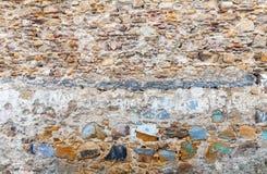 Alte bunte Steinwand-Hintergrundbeschaffenheit Lizenzfreies Stockfoto