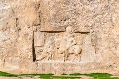 Alte Carvings an Friedhof Naqsh-e Rustam im Iran Stockfotos
