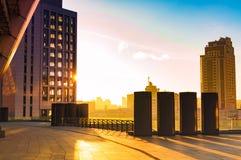 Alte costruzioni della città nel tramonto Fotografie Stock Libere da Diritti