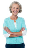 Alte Dame in der Freizeitkleidung, die sicher aufwirft Lizenzfreie Stockbilder