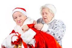 Alte Dame-Schnee-Maid und Sankt Lizenzfreie Stockbilder