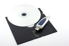 Alte Diskette, CD-ROM und USB-Speicher Stockbild