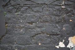 Alte dunkelgraue Backsteinmauerbeschaffenheit für Hintergrund Lizenzfreies Stockbild