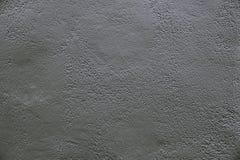 Alte dunkelgraue Betonmauerhintergrundbeschaffenheit Lizenzfreie Stockbilder