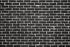 Alte dunkle Backsteinmauerbeschaffenheit oder -hintergrund Stockfoto