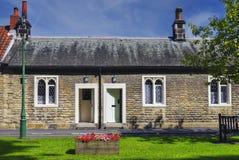 Alte englische Armenhäuser Stockfotos