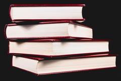 Alte Enzyklopädien auf schwarzem Hintergrund Lizenzfreie Stockfotografie