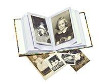 Alte Familien-Fotos und Buch Lizenzfreie Stockbilder