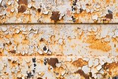 Alte Farbe auf einem rostigen Eisenblatt Stockfotos