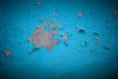 Alte Farben- und Zementwand, gebrochene Wandfarbblauvignette Stockfoto