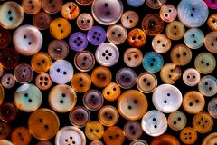 Alte farbige Plastikknöpfe Stockfoto