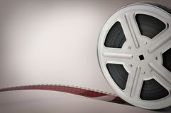 Alte Filmbildfilmrolle auf braunem Hintergrund Lizenzfreies Stockbild