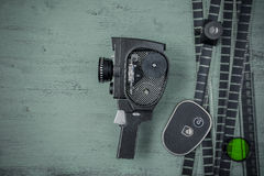 Alte Filmkamera und -film Lizenzfreies Stockfoto