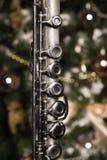 Alte Flöte nahe einem Baum des neuen Jahres Stockfotos
