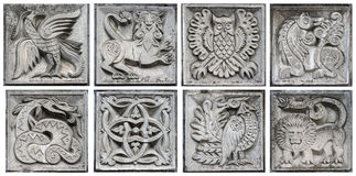 Alte Flachreliefs der Märchentiere Stockbild