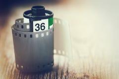 Alte Fotofilmkassette Retro- angeredetes Foto mit einem Glüheneffekt Lizenzfreie Stockfotos